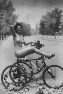Naked woman on tricycle
